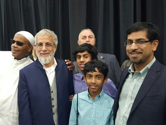 Rashed Fakhruddin and his sons pose for a photo with
