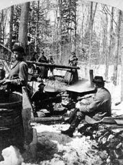 Circa 1860-1670: Amid barrels and stacks of firewood, Vermonters gather to boil down maple sap (exact location unknown).