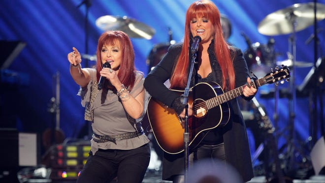 Naomi Judd, left, and Wynonna Judd, perform at the Girls' Night Out: Superstar Women of Country in Las Vegas on April 4, 2011.