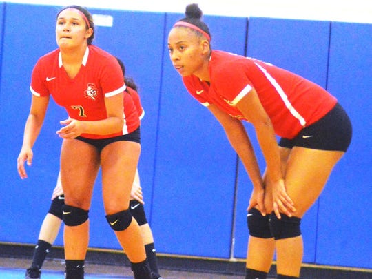 Elmwood Park seniors Alyssa Barrios (7) and Charelle Charles helped lead the Lady Crusaders to their best season in several years with a 25-6 record.