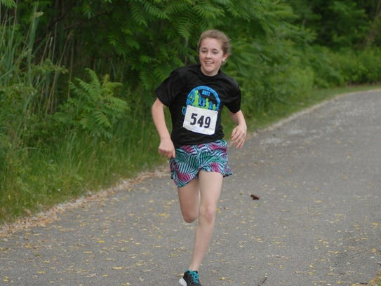 Madison Camm, 12, wins the mile run at the K's for
