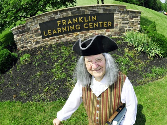 Bob Harrison appears as Ben Franklin at the entrance to Franklin Learning Center, one of the learning institutions in Franklin County inspired by the memorable Philadelphian who loved learning.