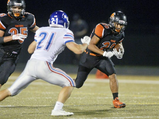 Chris Dunn — GameTimePA.com York Suburban's Jadon Haynes runs for positive yardage against Spring Grove's Ryan Daugherty in the Trojans' Week 3 victory. The Trojans have won three straight after dropping their first two games of the season.