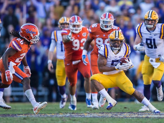 LSU Tigers running back Derrius Guice (5) looking for the running lane as the Tigers fall to the Gators by a final score of 16-10 in Death Valley, November 19, 2016.