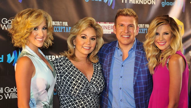 """Reality TV stars Julie and Todd Chrisley, center, at the 2015 Concert for Love and Acceptance in Nashville, plan to open a restaurant in downtown Nashville in 2019. The Chrisleys, stars of USA Network's """"Chrisley Knows Best,"""" have lived in Nashville since 2015."""