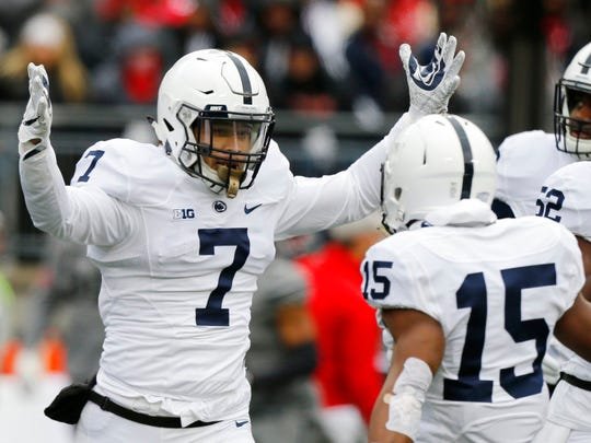 Penn State linebacker Koa Farmer celebrates recovering a fumble against Ohio State during the first half of an NCAA college football game Saturday, Oct. 28, 2017, in Columbus, Ohio. (AP Photo/Jay LaPrete)