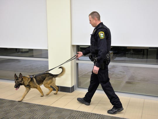 Sauk Rapids Police Officer Matt Bosma walks Thunder,