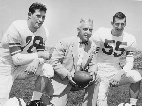 Former Penn State coach Rip Engle, center, poses for a picture in 1954.