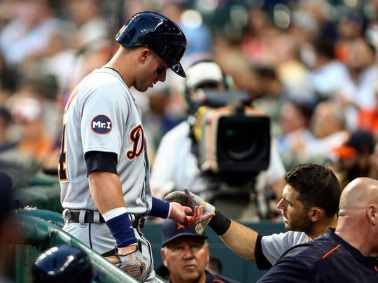 Tigers catcher James McCann (34) leaves the game with a bloody hand after getting hit by a pitch during the fourth inning of the Tigers' 7-6 loss Thursday in Houston.