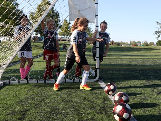 File photo - Missfits Xtreme under 11 girls team member Briana Jeter, center, goes through kicking drills Wednesday at the Redding Soccer Park. The team beat the Folsom Lake Earthquakes, the fourth-ranked team in the nation on Saturday, Aug. 26, 2017 in Folsom.