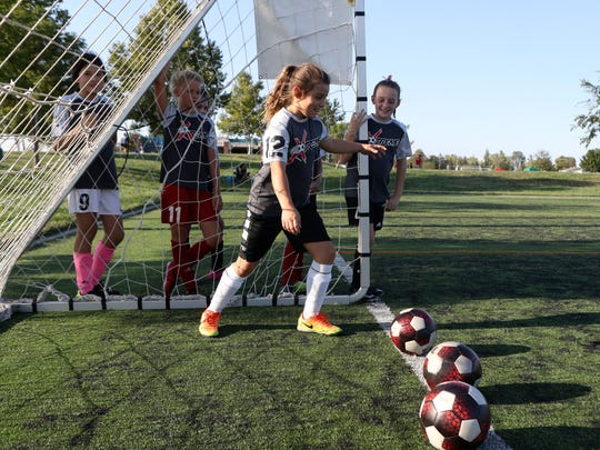 A youth soccer team practices at soccer park in 2017. The fields at the California Soccer Park have been deteriorating for years and need to be replaced. The cost to replace the four fields will be $4.7 million.