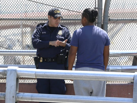A Customs and Border Protection officer talks with a border crosser Tuesday morning at the top of the Paso del Norte bridge, where the international boundary is located.