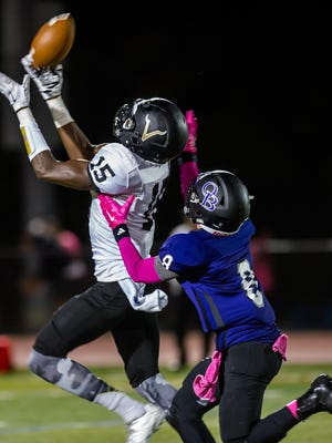 South Brunswick's Justin Shorter attempts to make a reception over Old Bridge's Anthony Imbimbo during their game in Old Bridge on Sept. 25, 2015. Photo by Jeff Granit