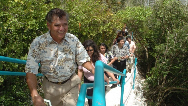 In this 2005 file photo, Hotel Nikko Guam Assistant General Manager Joe Blas, left, leads visitors on the limestone forest nature trail at the Tumon hotel. Blas was reelected as chairman of the Guam Hotel and Restaurant Association board of directors.