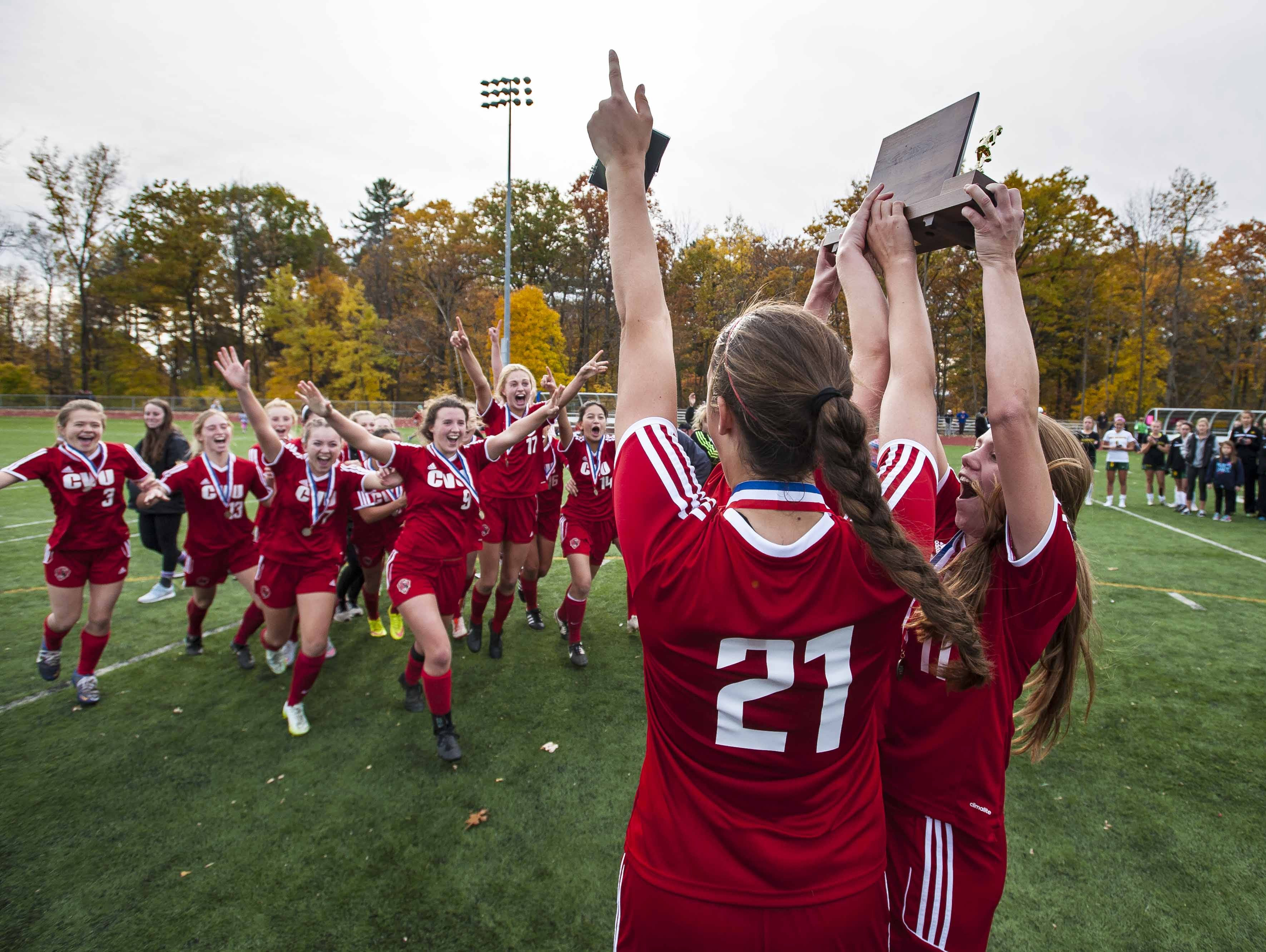 CVU celebrates its victory over Burr and Burton in the Division I girls soccer championship at Burlington High School on Saturday.