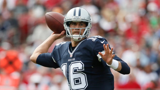 Dallas Cowboys quarterback Matt Cassel (16) drops to throw a pass during the first quarter of a football game against the Tampa Bay Buccaneers at Raymond James Stadium.