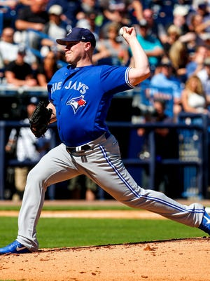 \Toronto Blue Jays starting pitcher Brett Oberholtzer throws a pitch in the second inning of a baseball game against the New York Yankees during spring training at George M. Steinbrenner Field.