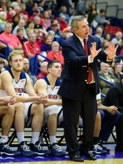 USI Head Coach Rodney Watson talks to the players from the sideline during the second half against the Lewis University Flyers at USI's Physical Activities Center in Evansville, Ind., Thursday, Nov. 30, 2017. After going into overtime, the Screaming Eagles defeated the Flyers, 84-75.