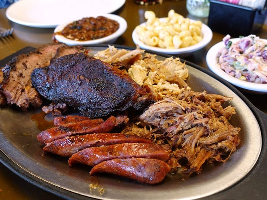 A selection of barbecue (beef brisket, pork ribs, pulled chicken, pulled pork and hot links) at Hek Yeah BBQ.