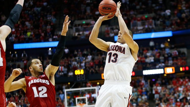 Arizona's Nick Johnson shoots a jumper but time had run out in overtime against Wisconsin in the NCAA West Regional Final on Saturday, March 29, 2014 at the Honda Center in Anaheim.