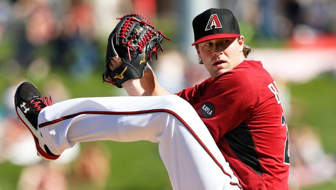 Arizona Diamondbacks Archie Bradley throws to the Colorado Rockies during spring training action on March 5, 2015, at Salt River Fields at Talking Stick.