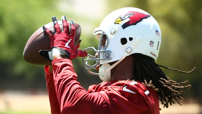 Arizona Cardinals wide receiver Larry Fitzgerald makes a catch during voluntary Organized Team Activities on June 7, 2018 at the Arizona Cardinals Training Facility in Tempe, Ariz.