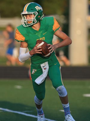 Floyd Central's Matt Weimer went 5-for-7 for 171 yards and two touchdowns in the first half of the Highlanders' 62-19 win over Providence Aug. 25 in Floyds Knobs.