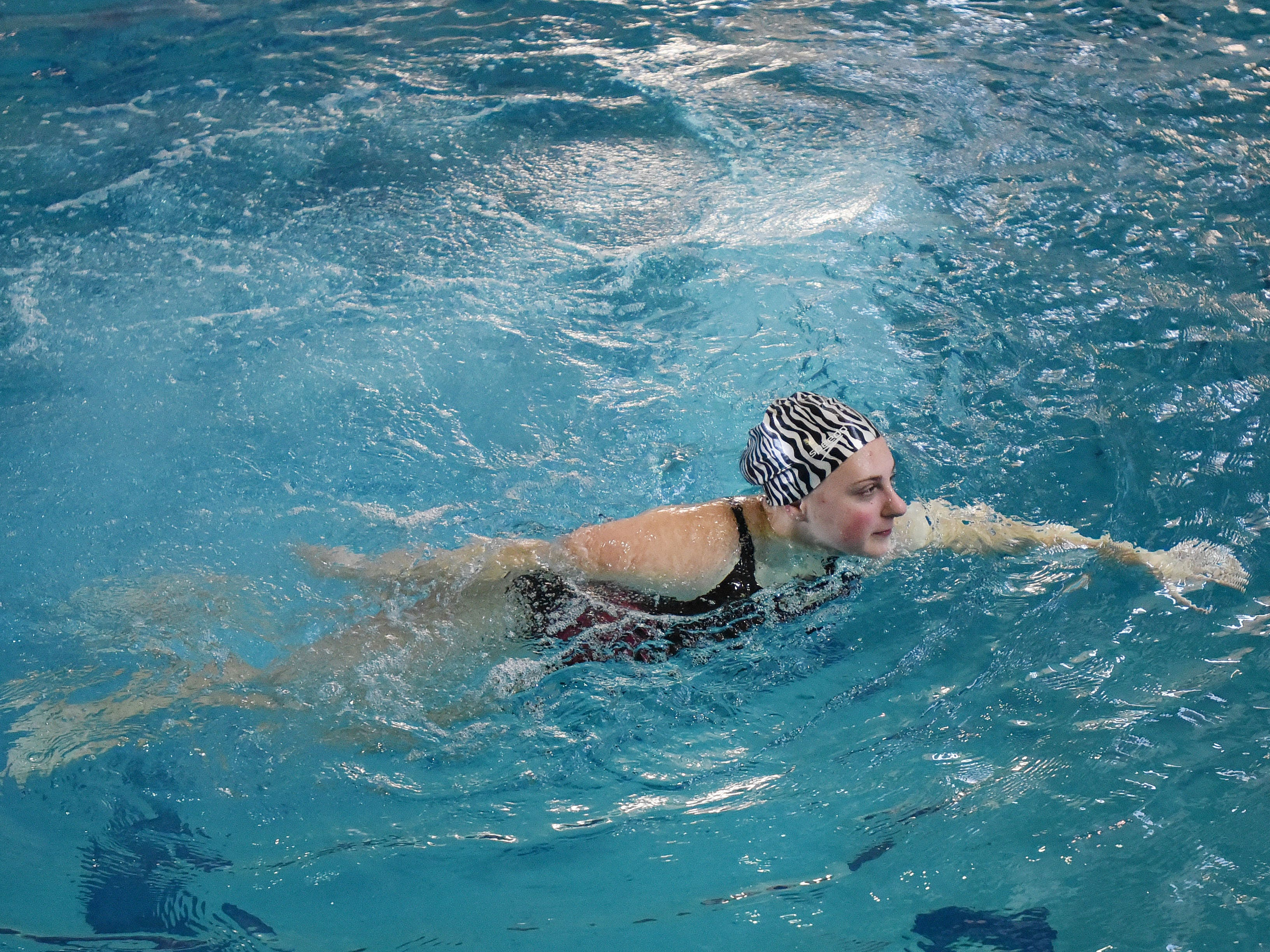 Silverton's Madison Cock, who has signed a letter of intent to compete in diving at the University of Utah, practices on Wednesday, April 15, 2015, at the Tualatin Hills Park & Recreation Center in Beaverton.