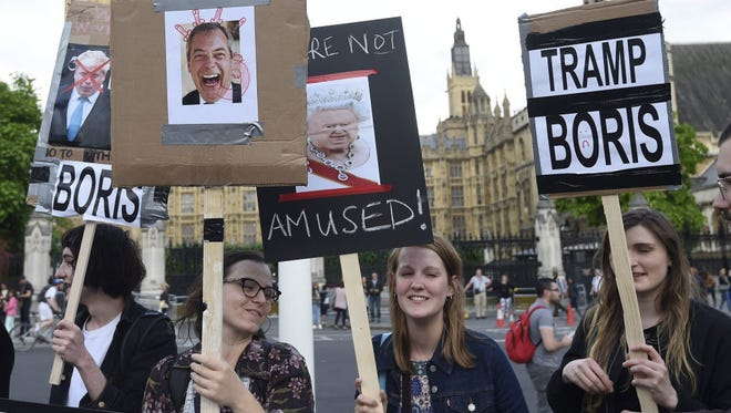 Protestors gather outside the Houses of Parliament in London after the Brexit decision was announced.