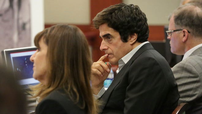 Illusionist David Copperfield, center, looks on during opening statements in a civil trial at the Regional Justice Center in Las Vegas on Friday, April 13, 2018.