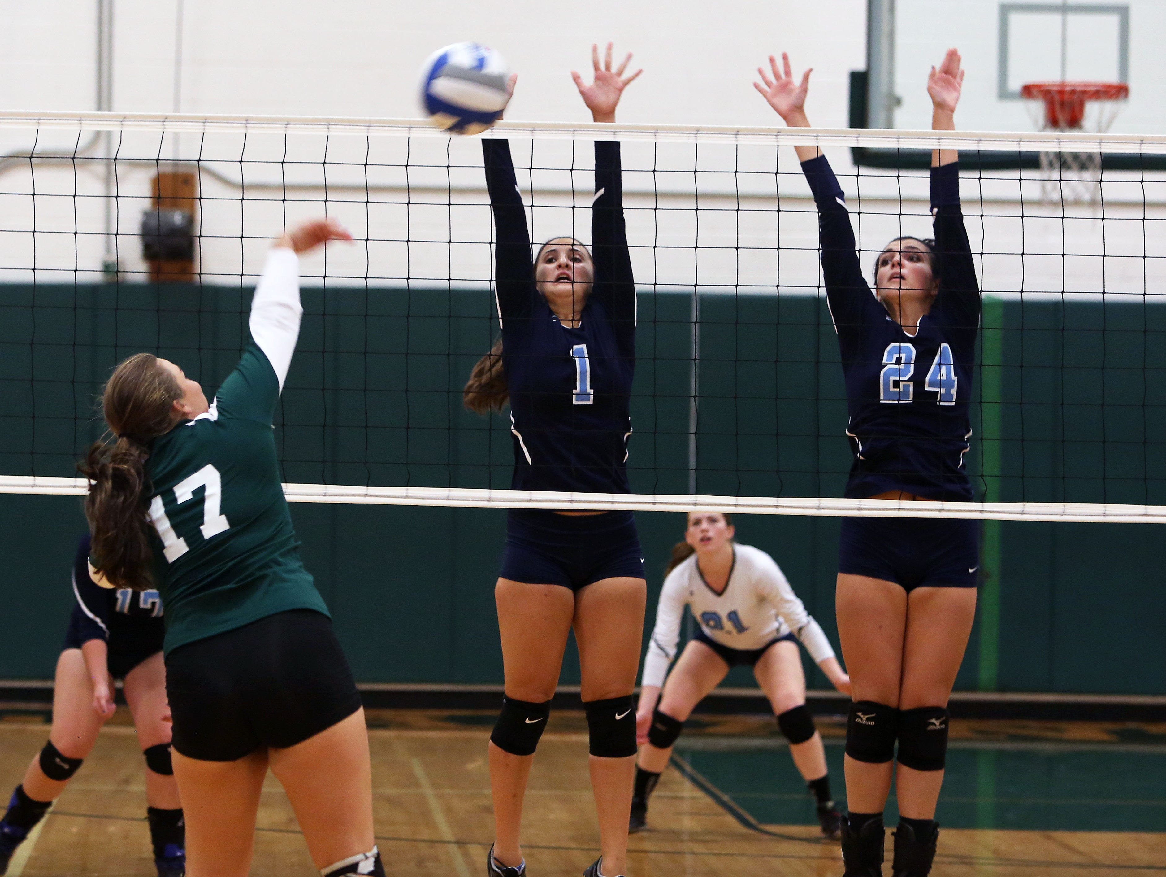 From right, Westlake's Kelly Martin (24) and Angelina Guarnieri (1) combine to stop a shot by Pleasantville's Isabelle Minerva (17) during volleyball action at Pleasantville High School Sept. 30, 2015.