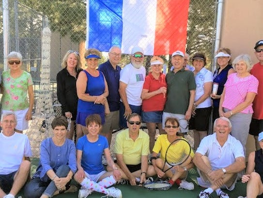 Alto Lakes Tennis Association celebrated the French Open Grand Slam Tennis Tournament with a local version. The group played with Babolat French Open tennis balls and quenched their thirst with Evian water. Between games of tennis, they indulged in La Madeline French pastries, raspberry crepes, Madeline's, croissants, lemon tarts and quiches and strawberries.