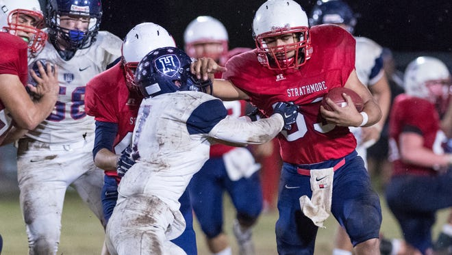 Strathmore's Joseph Garcia attempts to shed a tackle against Horizon Christian Academy in a CIF Regional Football Championship Bowl Game on Saturday, December 10, 2016. Strathmore is the first Tulare County team to host a CIF Regional Championship Bowl Game.