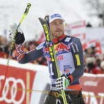 Bode Miller arrives for the podium ceremony after the FIS men's Alpine ski World Cup Downhill race in Kitzbuehel on Saturday.