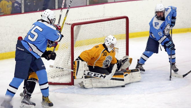 McQuaid plays Pelham during the Great 8 Plus 1 Ice hockey tournament at the Ice Hutch in Mount Vernon Dec. 9, 2016.