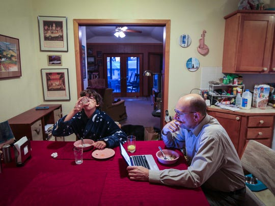 Bill Brauch and his daughter, Rachel, who attends Meredith Middle School in Des Moines, eat breakfast before heading to school Friday morning. Rachel often wakes as early as 6 a.m. to attend orchestra practice before middle school.
