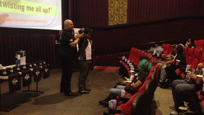 Why'd You Stop Me Founder Jason Lehman interacts with an audience member during a simulation.