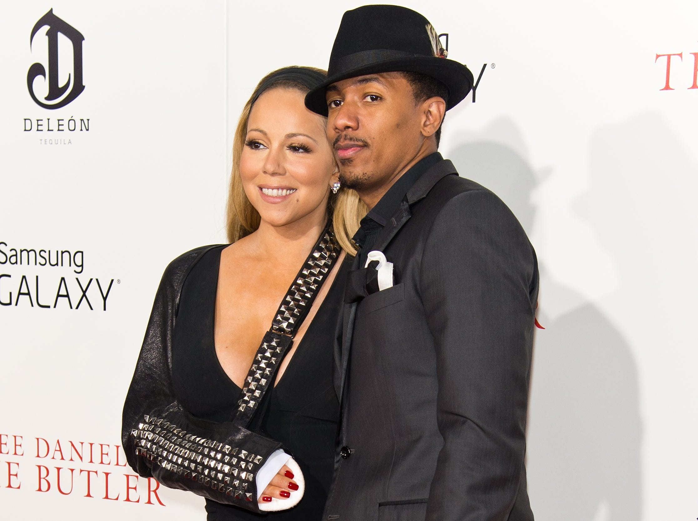 "Carey showed off her black studded sling with husband Nick Cannon by her side on Aug. 5. The couple spent their date night at 'The Butler' premiere in NYC. Cannon actually directed the video shoot where Carey was injured. ""It was pretty serious,"" Cannon said on the 'Today' show. ""Not only did she dislocate her shoulder, she actually cracked a rib and ... she chipped her shoulder bone."""