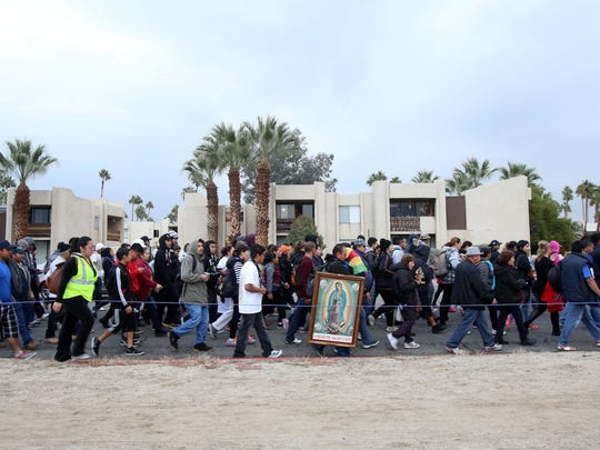 Thousands marched Friday along Highway 111 from Palm Springs to Coachella during the Virgen de Guadalupe procession.
