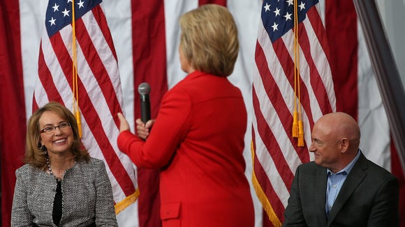 Gabby Giffords and her husband, Mark Kelly, look on