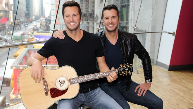 Luke Bryan attends the unveiling of his Madame Tussauds Nashville wax figure in Times Square on March 1, 2017, in New York City.
