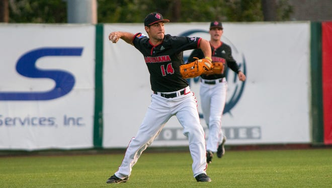 UL utility man Kennon Fontenot relays a throw from the outfield against Troy last Friday night at The Tigue.