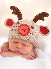 One of the adorable baby hats for sale.