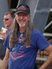 Pat Simmons of the Doobie Brothers  greeted other riders