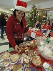Lori Hull of Mosinee looks over some of the baked goods at Mosinee's Christmas Festival held in the Mosinee High School Creske Center.
