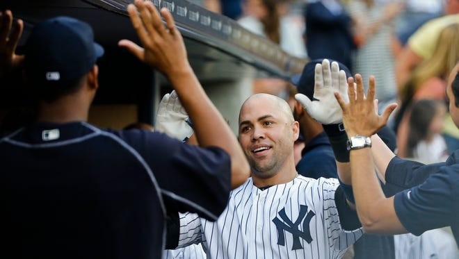 New York Yankees' Carlos Beltran celebrates with teammates after hitting a two-run home run during the first inning of a baseball game against the Los Angeles Angels on Tuesday, June 7, 2016, in New York.