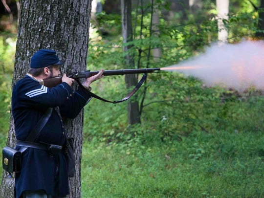 Sean Protas of Newport, historian with the 2nd Delaware Volunteer Infantry fires his musket during the skirmish with Confederate soldiers.