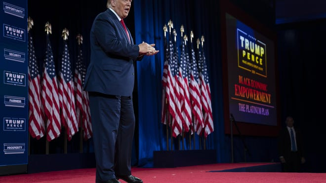 President Donald Trump arrives to speak at a campaign event at the Cobb Galleria Centre, Friday, Sept. 25, 2020, in Atlanta.