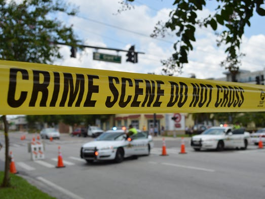 Police cordoned off the crime scenes in downtown Orlando