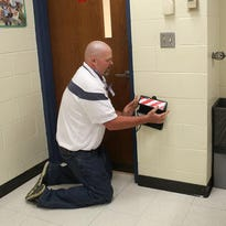 "Kings High School teacher Dustin Goldie demonstrates his classroom's ""Bearacade"" door block designed prevent a shooter or other violent intruder access to his classroom."